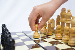 Chess. Beginning of the game.The chess pieces are placed on the chessboard. First step Royalty Free Stock Images