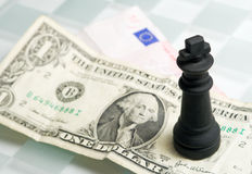 Chess and bills Royalty Free Stock Images