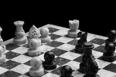 Chess on a black background Stock Images
