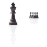 Chess. Black king, pawns shadows on white Stock Image