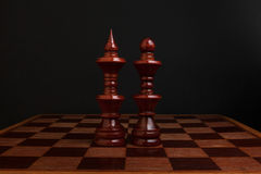 Chess. Black King and Queen on wood board. The most powerful figures. Royalty Free Stock Image