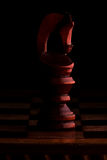 Chess. Black Knight Horse on black background. Stock Image