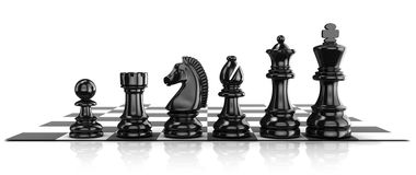 Chess black pieces, standing on board Royalty Free Stock Photography
