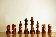 Chess - Black starting position. Frontal view on a wooden set of black chessmen in starting position royalty free stock image