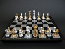 Chess Board. A magnetic chess table with mixed pieces on it royalty free stock photo