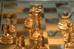 Chess Board. With king surrounded by pawns.  Symbolic of king's superiority over lesser pawns.  Pawns surrounding king to protect dependent king Royalty Free Stock Image