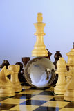 Chess board. Globe is placed in between the chess board and the king is on top of Globe Royalty Free Stock Photo