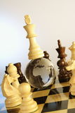 Chess board. Globe is placed in between the chess board and the king is on top of Globe Stock Images