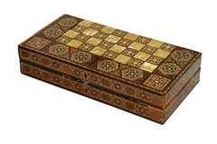 Chess Board. Old foldable chess-board box intricately designed with mother-of-pearl on finely carved wood Royalty Free Stock Images