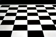 Chess board. Black and white chess squares on board Royalty Free Stock Photo