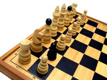 Chess board. A wooden chess board with pieces ready to play stock photography
