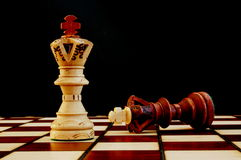 Chess board. Chess pieces on chess board showing power and success stock photography