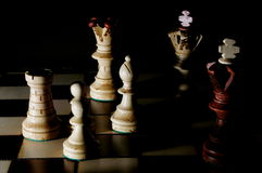 Chess board. Chess pieces on chess board showing power and success stock images