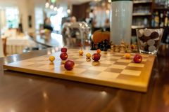Chess board with apples instead of figures stock photography