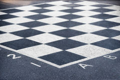 Chess board on asphalt Stock Photo