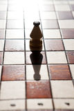 Chess board with bishop on light color background Royalty Free Stock Photo