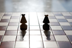 Chess board with bishop on light color background Stock Images