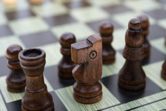 Chess board with black chess Royalty Free Stock Photos