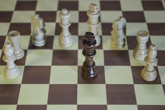 Chess Board - Black King surrounded by enemies. Black King surrounded by powerful enemies royalty free stock image