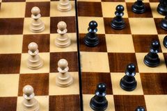 Chess board with black and white pawns Royalty Free Stock Photography