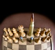 Chess Board and Bullets. Stock Image