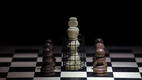 Chess board cage dark background. Day light stock video
