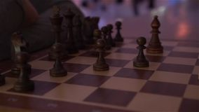 A Chess Board With Chess. At evening dark night scene with camera movement shot in slow motion with dynamic color of light stock video