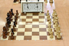 Chess board and chess clock Stock Photos