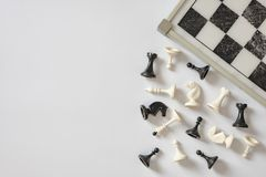Chess board and chess figures on white background top view copy space stock photography