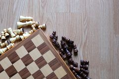 Chess board and chess figures on wooden table. Flay layout stock photos