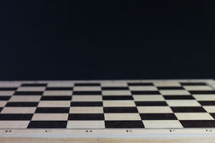 Chess board with chess pawns. Checkerboard black background. Stock Image