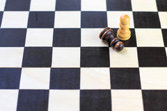 Chess board with chess pawns. Checkerboard black and white background. Stock Photos