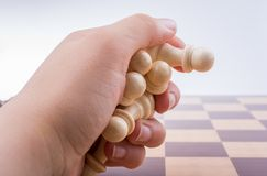 Chess board with chess pieces in hand Royalty Free Stock Images