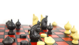 Chess board with chess pieces show black check and win game Stock Photography