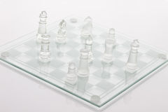 Chess board with chess pieces on white background Royalty Free Stock Photos