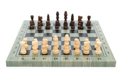 Chess board with chess pieces on white Stock Photography