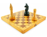Chess board and chessmens. Chess board and chessmen isolated on a white background Royalty Free Stock Photography