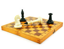 Chess board and chessmens. Isolated on a white background Royalty Free Stock Photo