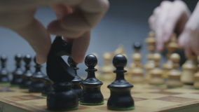 Two players prepering chess pieces before the game. Chess board with classic wood pieces. Dark background. Shot on RED Epic stock video footage