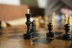 Chess Board close focused on black king and pawn Stock Photo