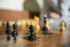 Chess Board close focused on black pawn Stock Photos