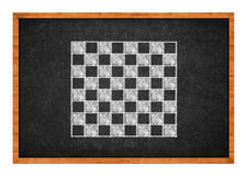 Chess board drawing on a black chalkboard Royalty Free Stock Image