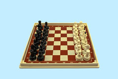 Chess-board with figures Stock Photos