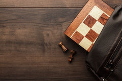Chess board with figures in the brown bag Royalty Free Stock Photos