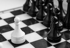 Chess board with figures close-up, monochrome. Chess board with figures close-up photo, monochrome Royalty Free Stock Photography