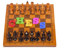 Chess board with figures with plastic letter Royalty Free Stock Images