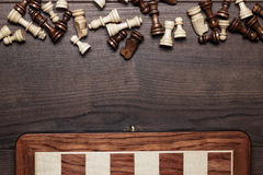 Chess board and figures on woden background Stock Photo