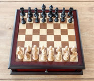 CHESS BOARD with figures wood background Stock Images
