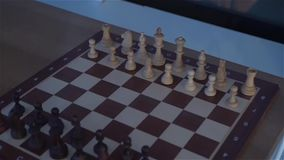 The Chess Board The Game. Caucasian white male hands at evening dark night scene slow motion dynamic color of light stock video