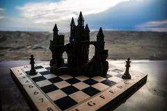 Chess board game concept of business ideas and competition. Chess figures on a chessboard. Outdoor sunset background. Chess board game concept of business ideas stock photography